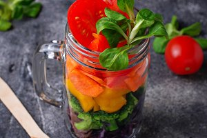 Vegetarian rainbow salad in a glass