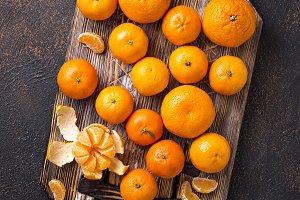 Fresh ripe tangerines on wooden