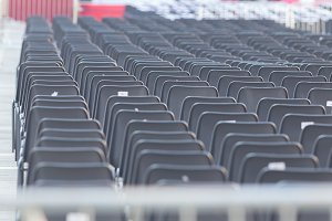 Rows of empty dark chairs. Abstract