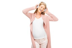 pregnant woman holding headphones wi