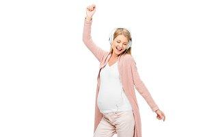 beautiful pregnant woman listening m