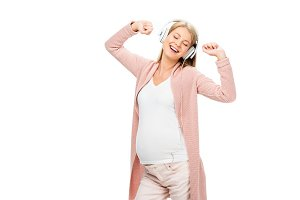 pregnant woman dancing with headphon