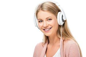smiling woman listening music, using