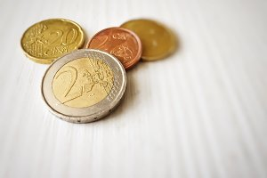 Group of euro coins on a white table
