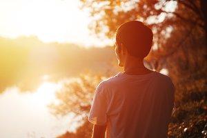 Young man enjoying the sunset sun