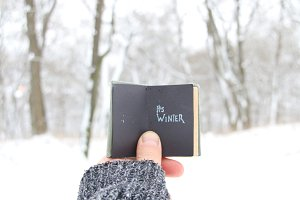 its winter, Hand holding a book with