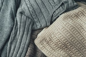 Background of warm knitted sweaters