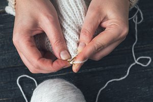 Female hands knitting close-up