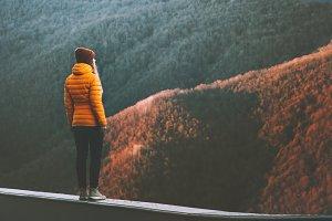 Woman exploring mountains adventure