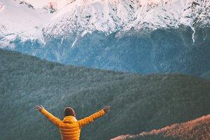 Woman traveler enjoying mountains