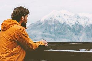 Traveler man enjoying mountains view