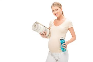 pregnant blonde woman holding fitnes