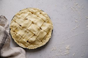 Uncooked apple pie with a wide latti