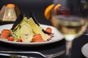 Caesar salad with salmon fish