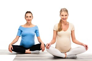 two beautiful pregnant women sitting