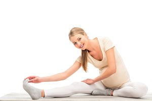 pregnant blonde woman stretching and