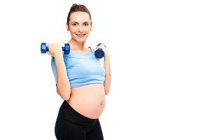 pregnant woman holding dumbbells nea