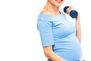 pregnant brown haired woman holding