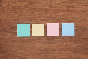 top view of four sticky notes on woo