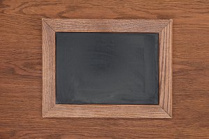 top view of empty chalk board on woo