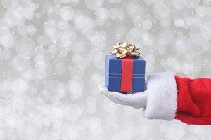 Santa Claus holding a blue gift box