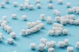 white sugar cubes on blue background