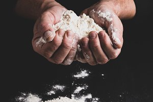 white wheat flour in male hands