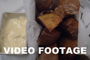 Eating baked potatoes with cream