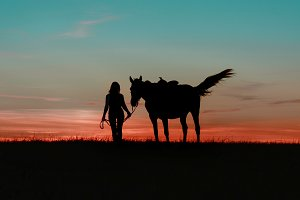 Graceful girl walking with horse