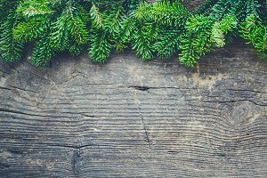 Christmas tree border on wooden