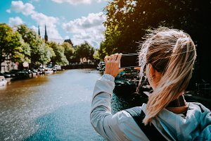 Female tourist taking photo of canal