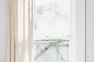 Bright Window with Linen Curtain
