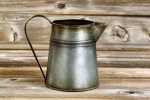 Old Metal pot on rustic wood