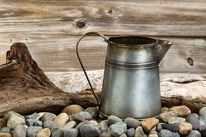 Metal coffee pot on stone fire pit