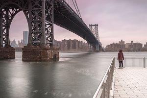Man on the pier at the bridge