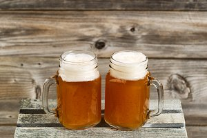 Beer in pint size jars on wood crate