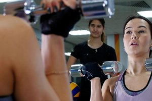 Training. A young woman pumps her