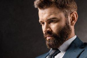 Brunet bearded businessman