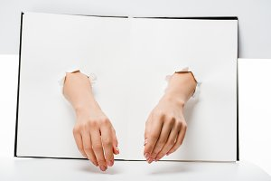 cropped shot of female hands through