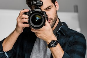 handsome young male photographer sho