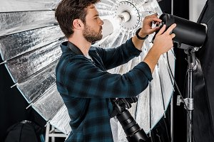 handsome young photographer working