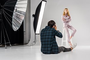 back view of photographer sitting an