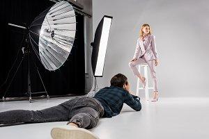 photographer lying and shooting beau