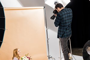 photographer standing on step ladder