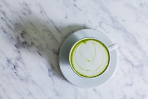 A cup of Matcha cappuccino with