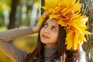 Autumn portrait Girl with a wreath