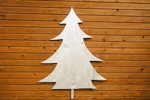 Silver tree on a wooden background