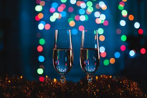 Glasses with champagne against firew