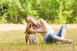 Joyfull woman and her dog in a