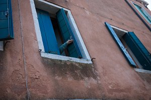 A resident opens a window in his